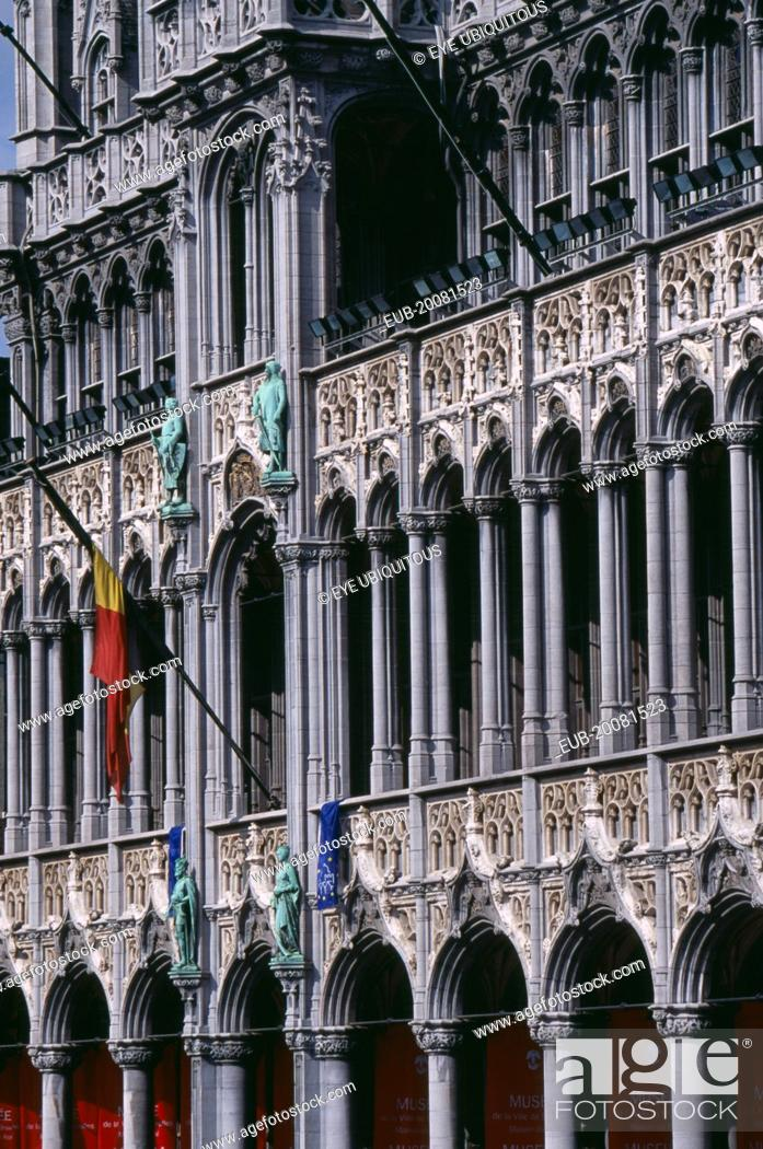 Stock Photo: Grand Place. Maison du Roi. Part view of exterior with carved colonnade and statues.