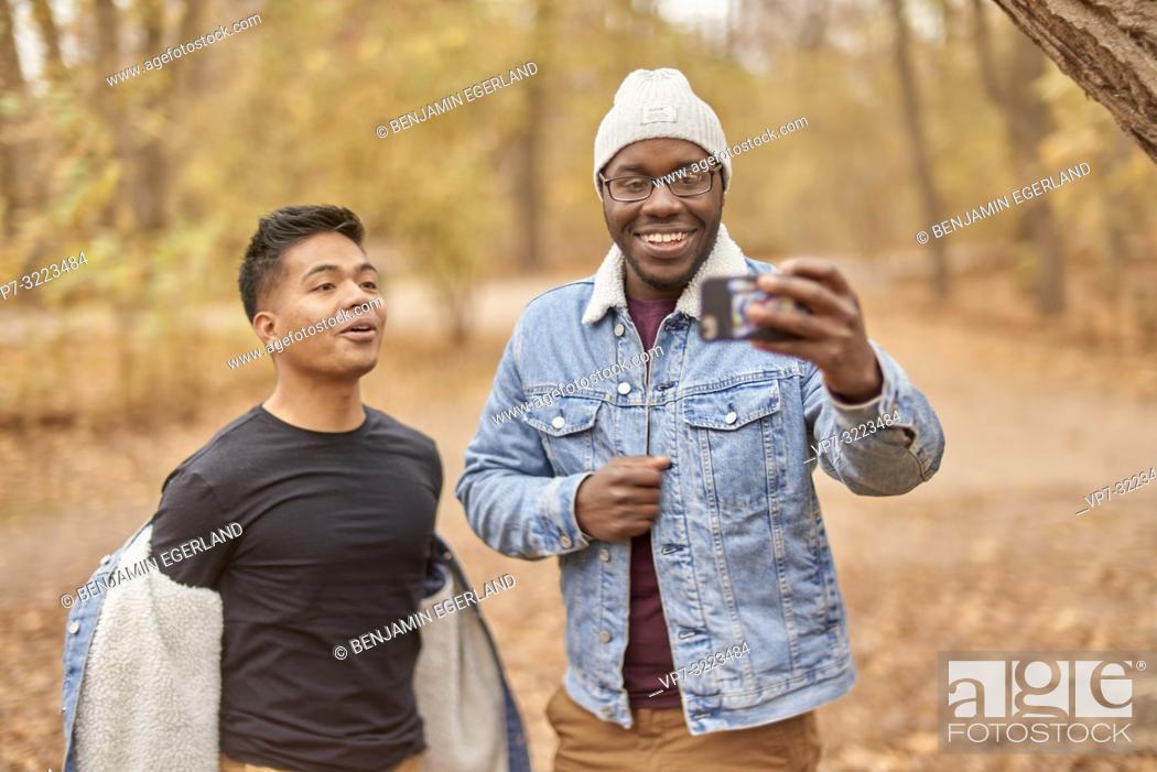 Stock Photo: friends taking selfie, nature, in park Englischer Garten, in Munich, Germany.