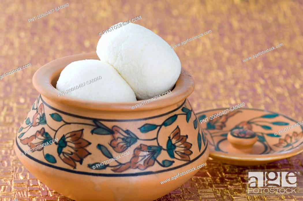 Stock Photo: Close-up of sponge Rasgullas in a bowl.
