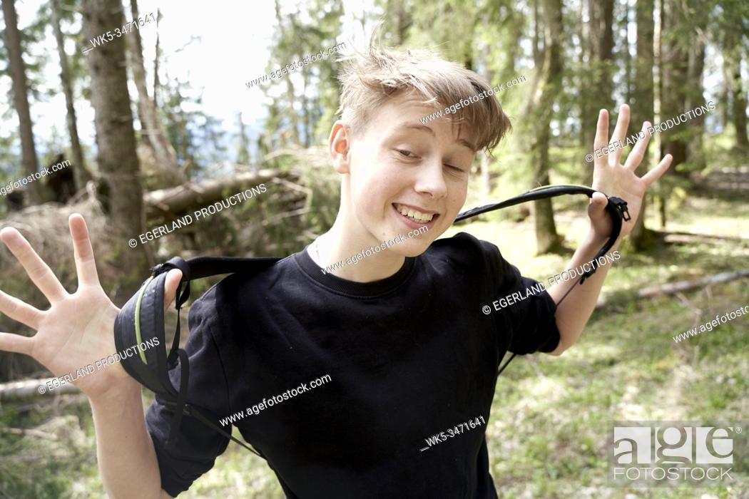 Stock Photo: Young boy in forest. Bad Tölz, Upper bavaria, Germany.