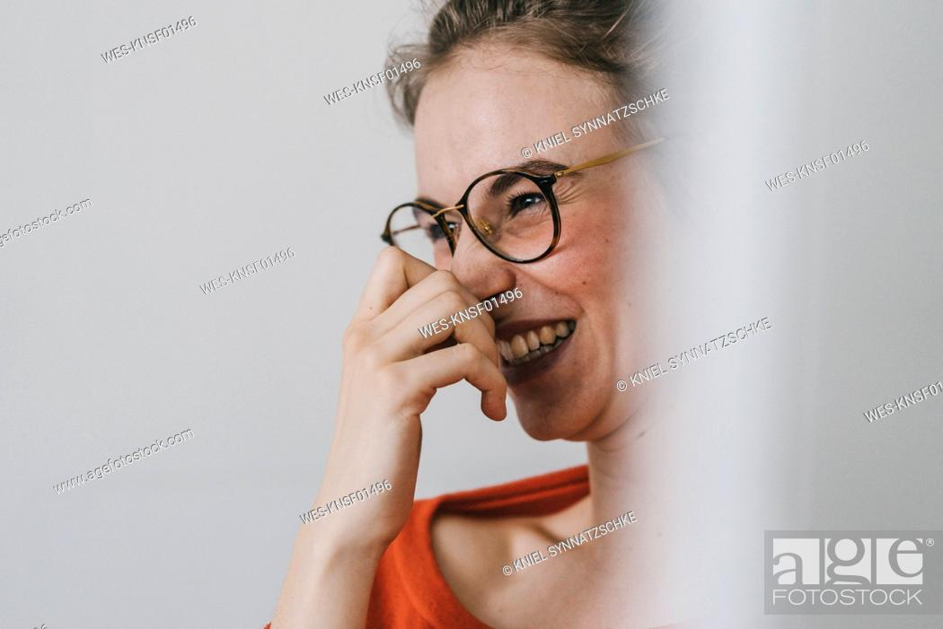 Stock Photo: Portrait of happy young woman with glasses.