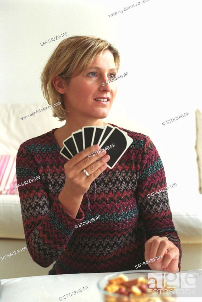Stock Photo: Woman holding Playing Cards.