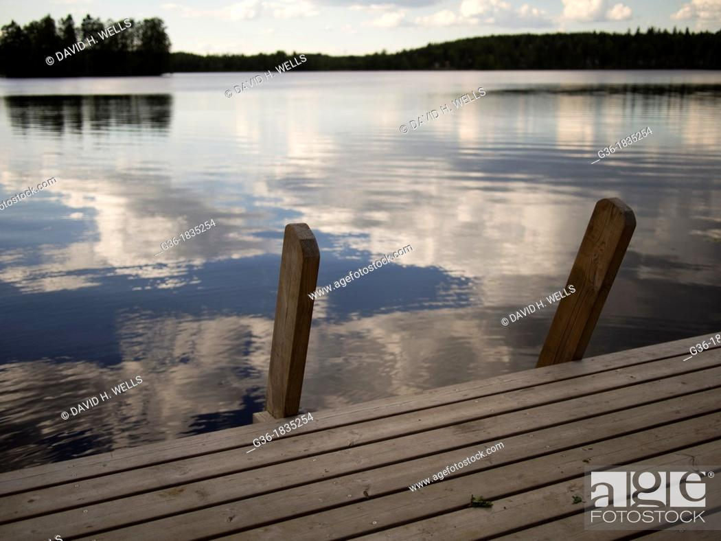 Stock Photo: Fresh water lake with dock in Nastoland, Finland.