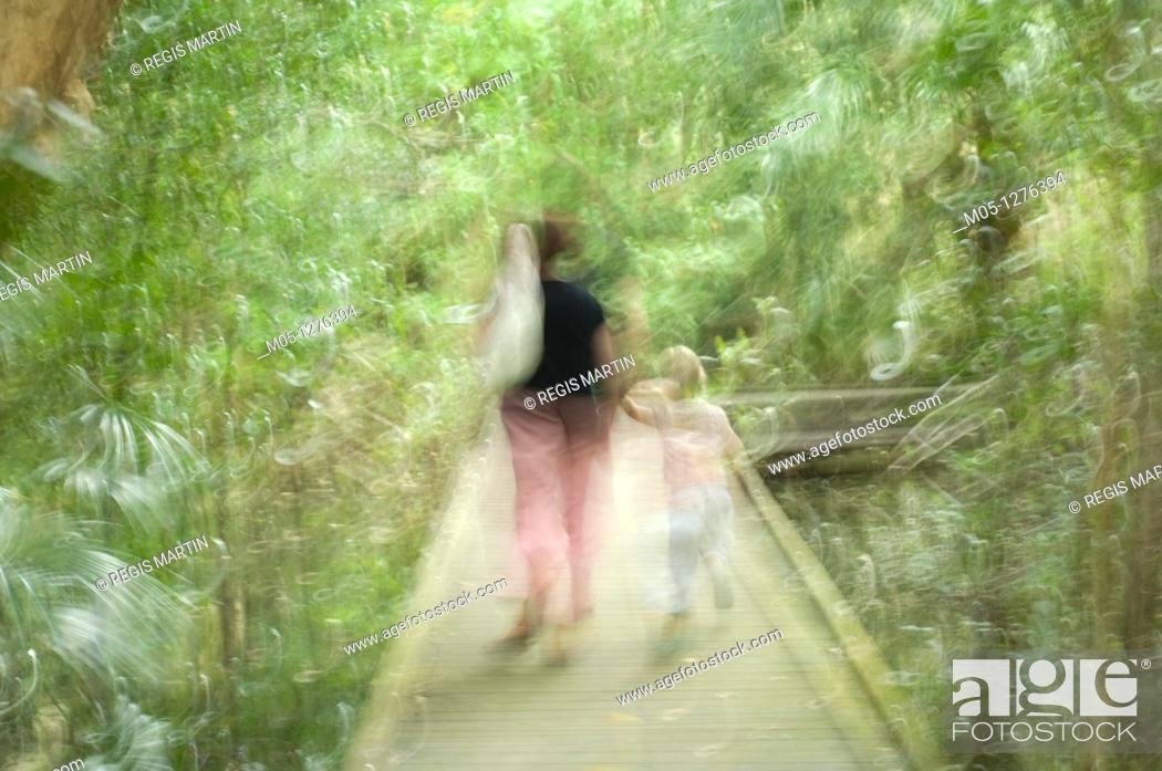 Stock Photo: A mother and child walking on a boardwalks at Fog Dam in the Northern Territory of Australia.