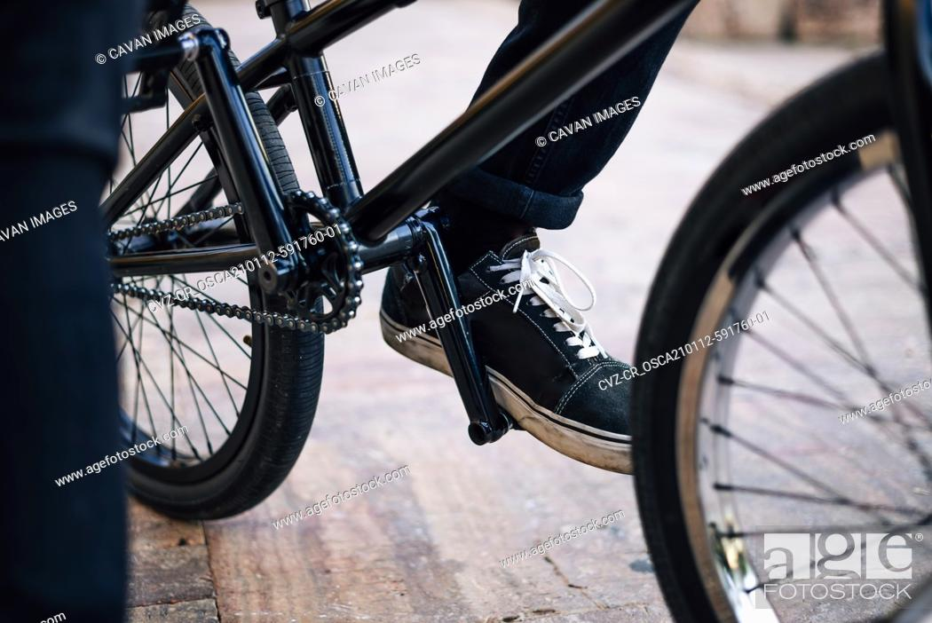 Stock Photo: Close up of a man posing with his bmx bike that his face cannot be seen.