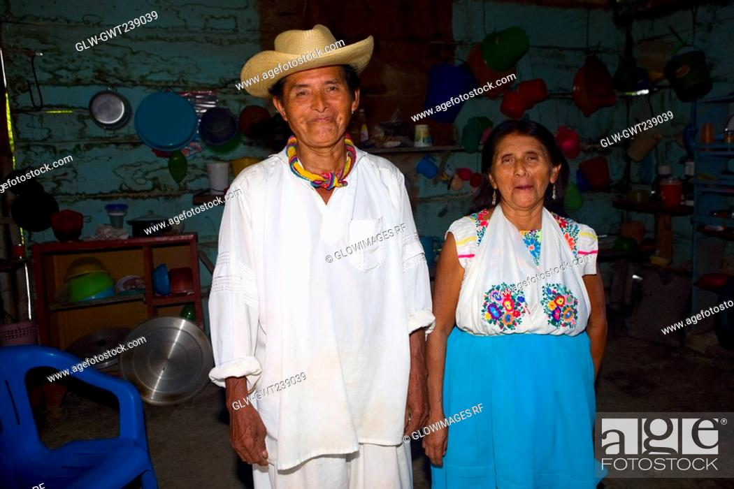 Stock Photo: Portrait of a mature couple standing in a kitchen, Papantla, Veracruz, Mexico.
