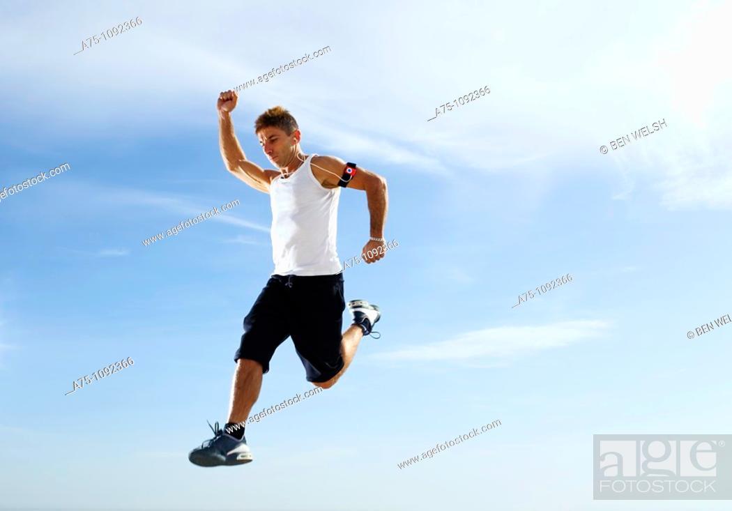 Stock Photo: Young man jumping.