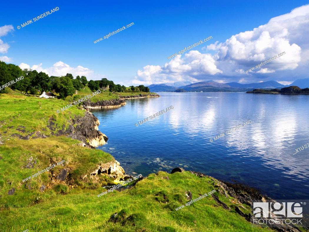 Stock Photo: White Cottage on the Shore overlooking the Lynn of Lorn Isle Lismore Argyll and Bute Scotland.