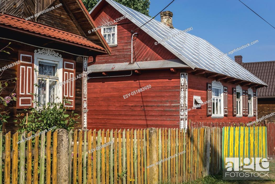 Stock Photo: Houses in Soce village on so called The Land of Open Shutters trail, famous for traditional architecture in Podlaskie Voivodeship, Poland.