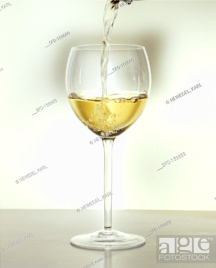 Stock Photo: Pouring a glass of white wine (2).