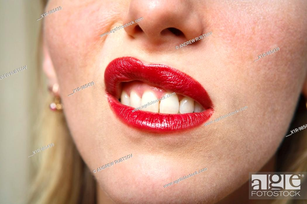 Stock Photo: Young woman with a disdainful expression, lip turned up scornfully or skeptically.