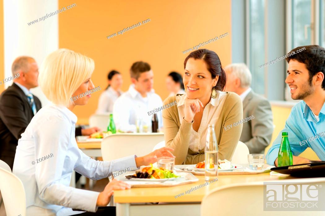 Stock Photo: Cafeteria lunch young business people eat salad.