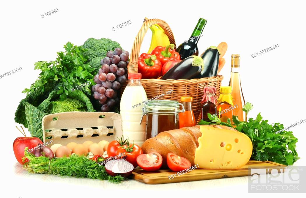 Stock Photo: Groceries in wicker basket including vegetables, fruits, bakery and dairy products and wine isolated on white.