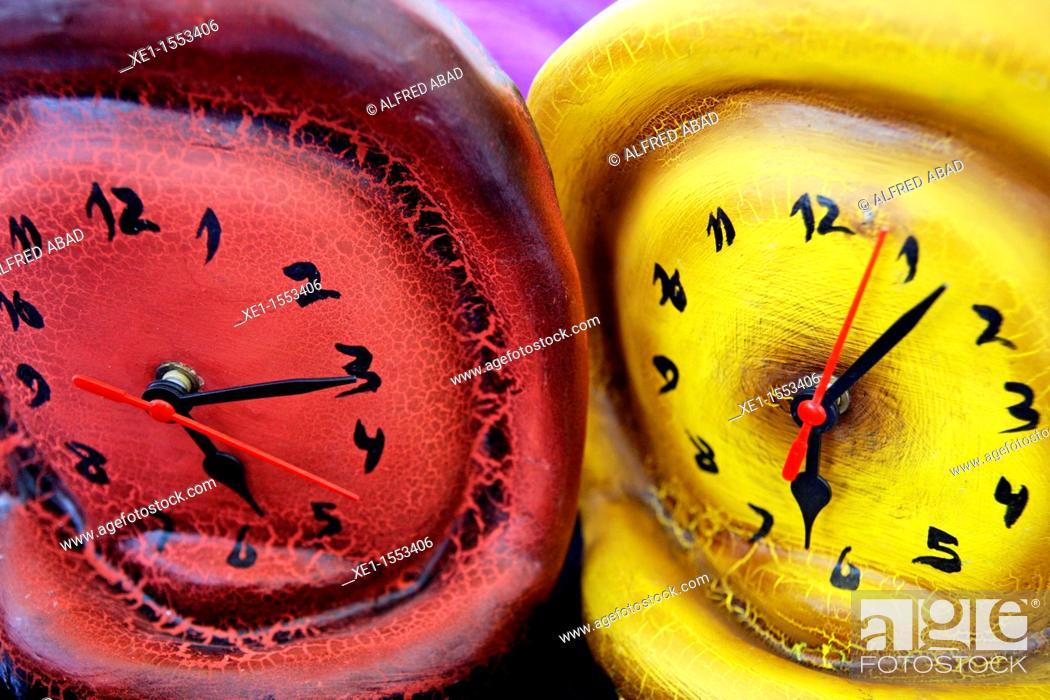 Stock Photo: colored clocks of mache paper.