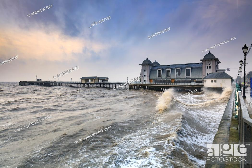 Stock Photo: The Victorian Pier at Penarth near Cardiff in South Wales, captured at sunrise from the promenade on a stormy morning in mid February.