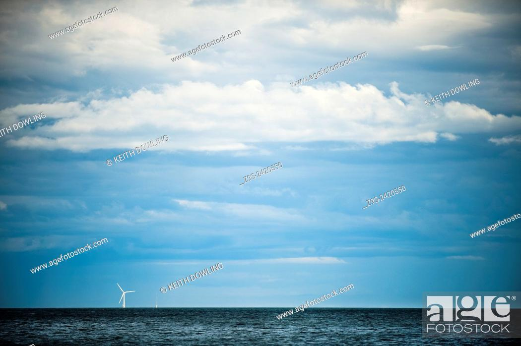 Stock Photo: Wind Turbine just below the Horizon of the East Coast of Ireland at Arklow Pier. Generating power for the Irish Electricty grid and beyond.