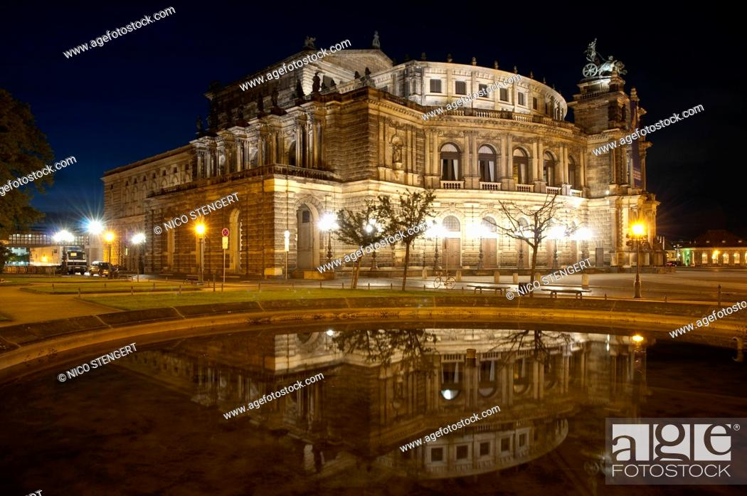 Stock Photo: Semperoper at night with a reflection in water, Dresden, Germany.