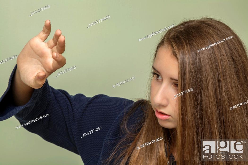 Stock Photo: Teenage girl with her arm raised.