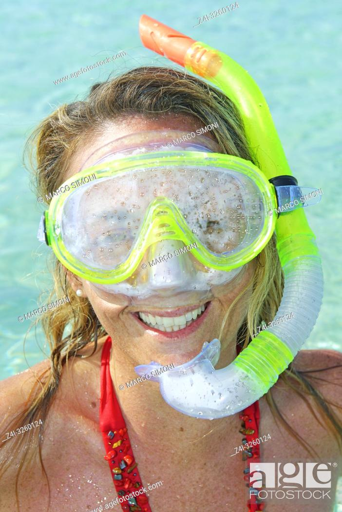 Stock Photo: A woman smiling wearing snorkeling gear, Formentera, Baleric Islands, Spain.