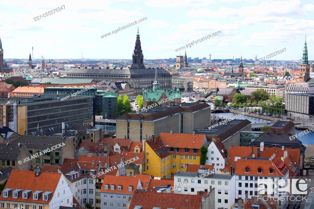 Stock Photo: Copenhagen, Denmark - June 22, 2019 : Aerial view on the city from the spiral tower Church of Our Saviour. Christiansborg Palace.