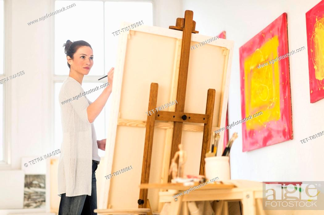 Woman painting at easel, Stock Photo, Picture And Royalty ...