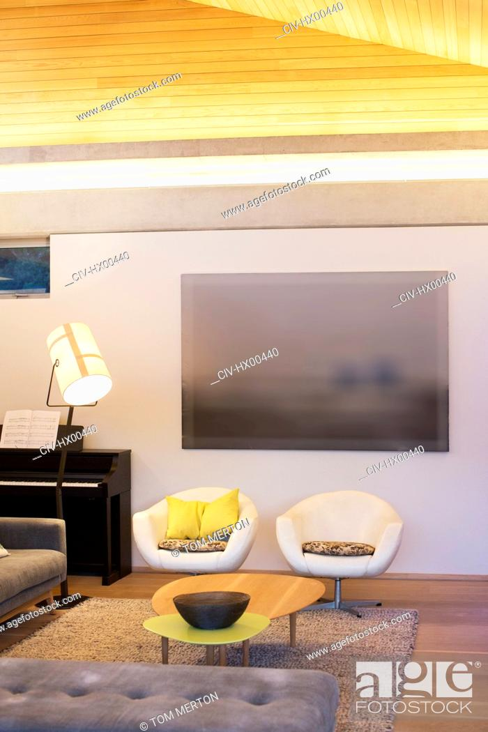 Photo de stock: Illuminated living room.