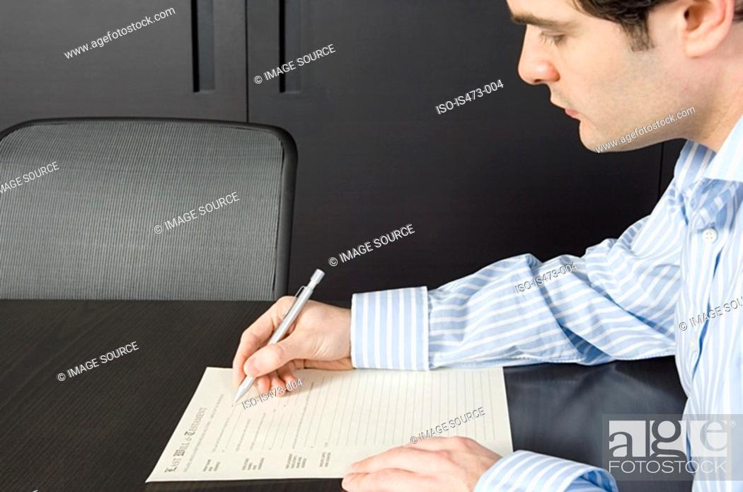 Stock Photo: Man signing will.