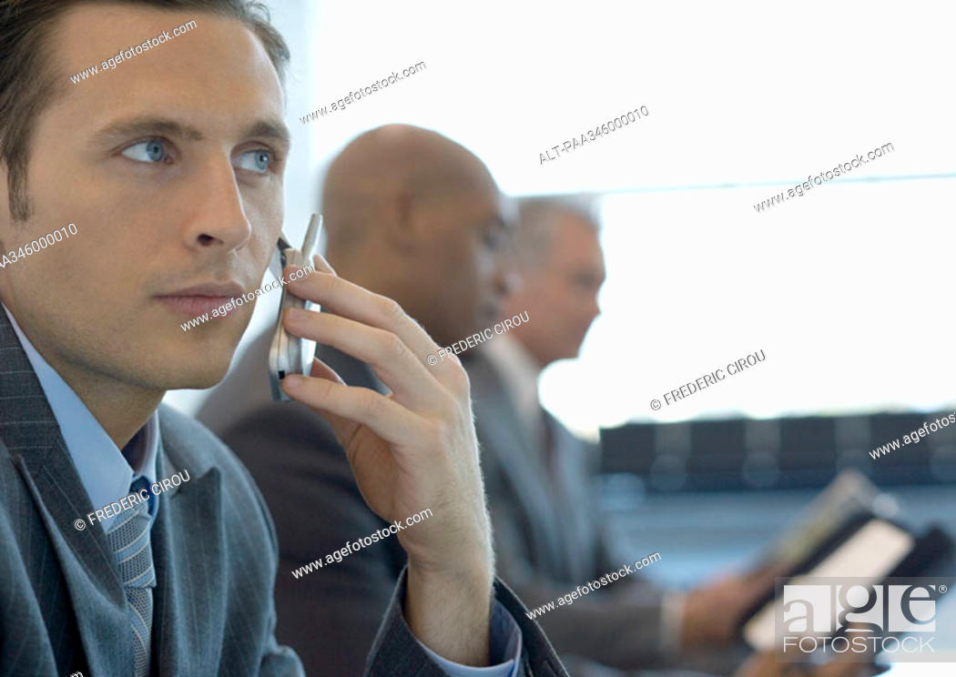 Stock Photo: Businessman using cell phone.