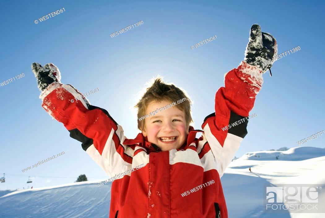 Stock Photo: Italy, South Tyrol, Seiseralm, Boy 4-5 cheering, portrait, close-up.