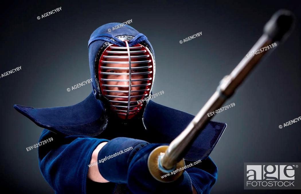 Portrait of kendoka with bamboo sword  Japanese martial art of sword