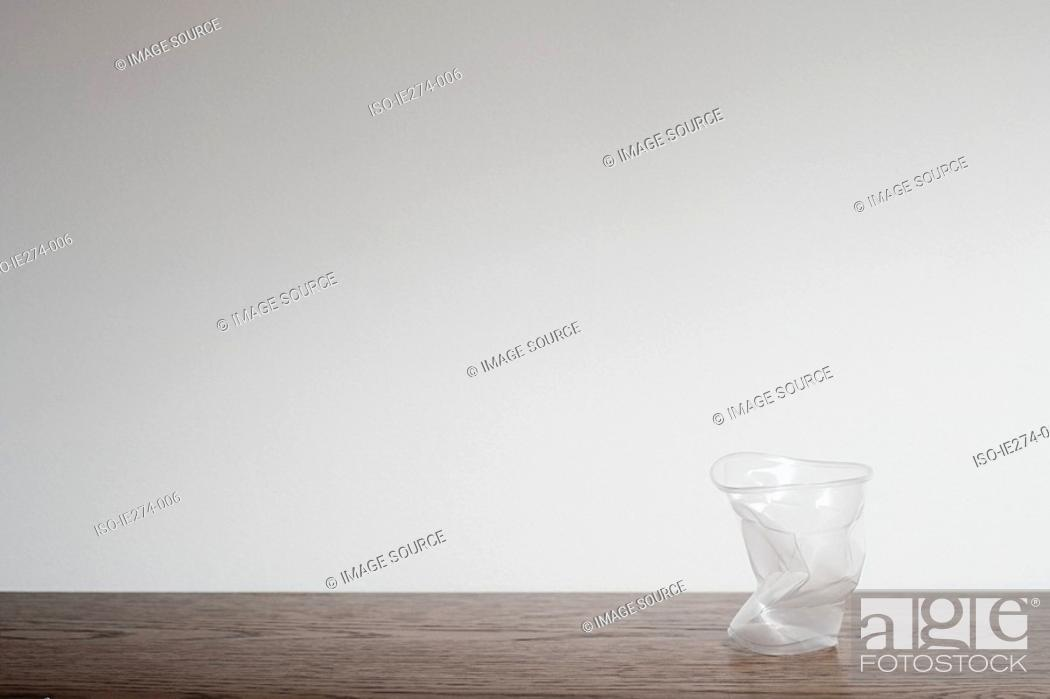 Stock Photo: Squashed plastic cup.