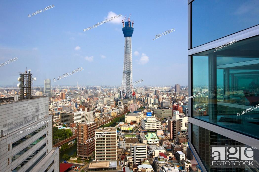 Stock Photo: Asahi Beer Tower and Tokyo Sky Tree under construction, Sumida, Asakusa, Tokyo, Japan.