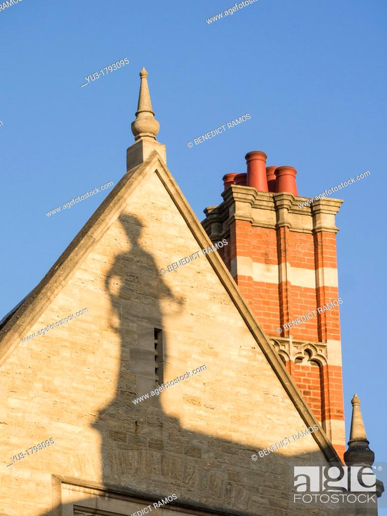 Stock Photo: Shadow of statue from the Clarendon Building, Catte Street, Oxford, England, UK.