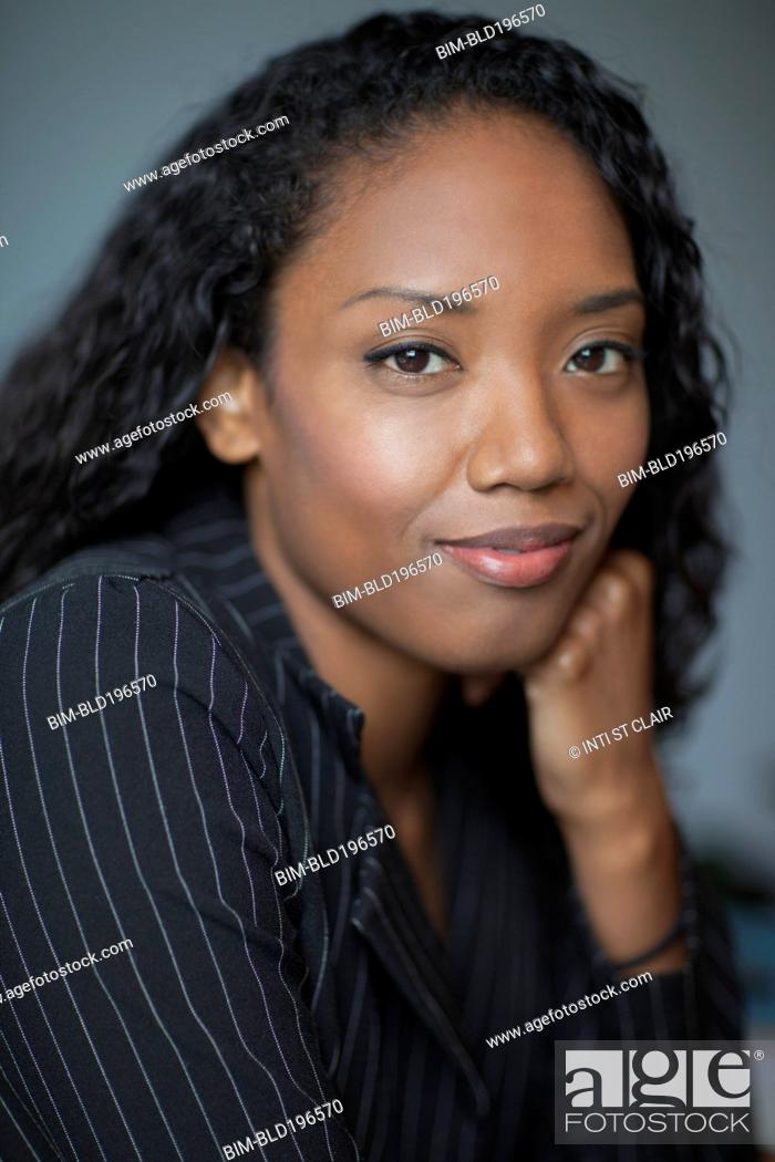 Stock Photo: Smiling mixed race businesswoman.