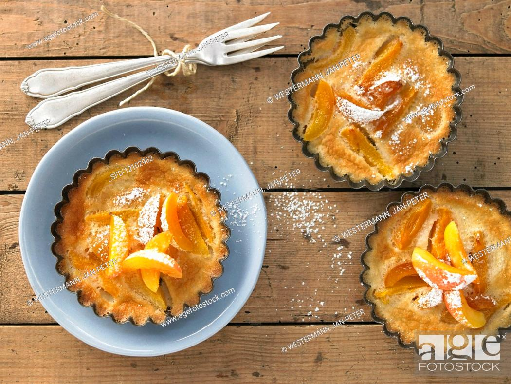 Stock Photo: Apricots cakes with vanilla and icing sugar.
