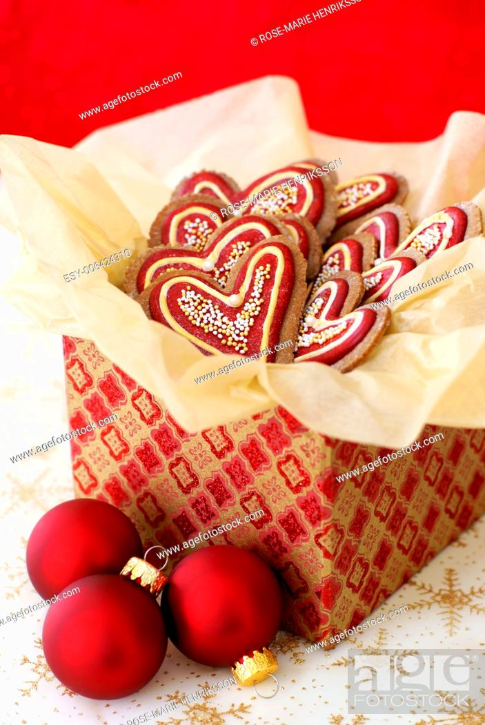 Stock Photo: Christmas decorated gingerbread cookies in a giftbox.
