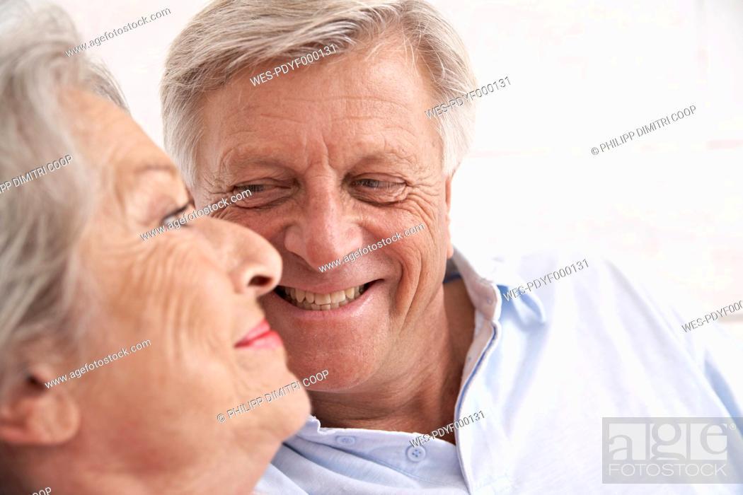 Stock Photo: Spain, Senior couple in hotel, smiling.