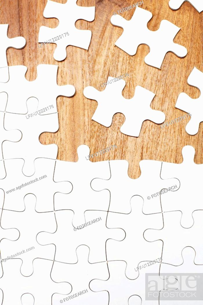 Stock Photo: Jigsaw puzzle on wooden background.