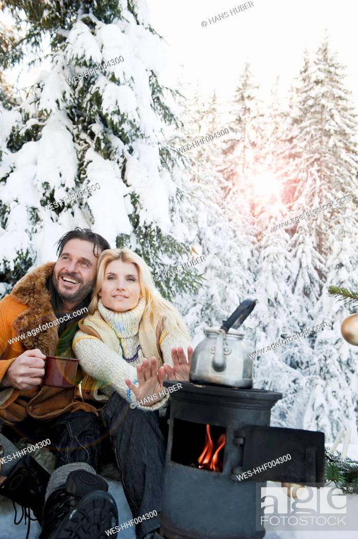 Stock Photo: Austria, Salzburg County, Couple sitting near camping stove and drinking tea.