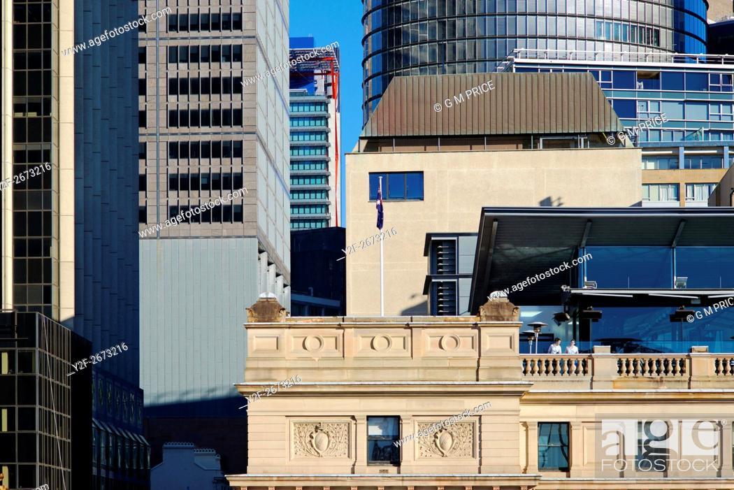 Stock Photo: Sydney office buildings from Cahill Expressway with two women on terrace of Customs House.