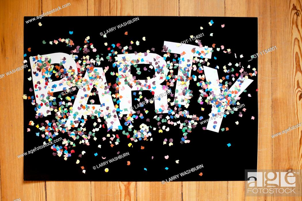 Stock Photo: Confetti and letters spelling PARTY on a black poster board.