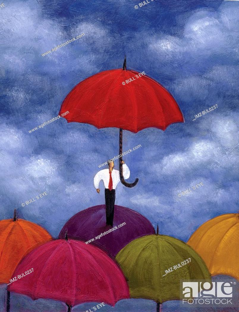Stock Photo: Businessman standing under red umbrella while standing atop several umbrellas.