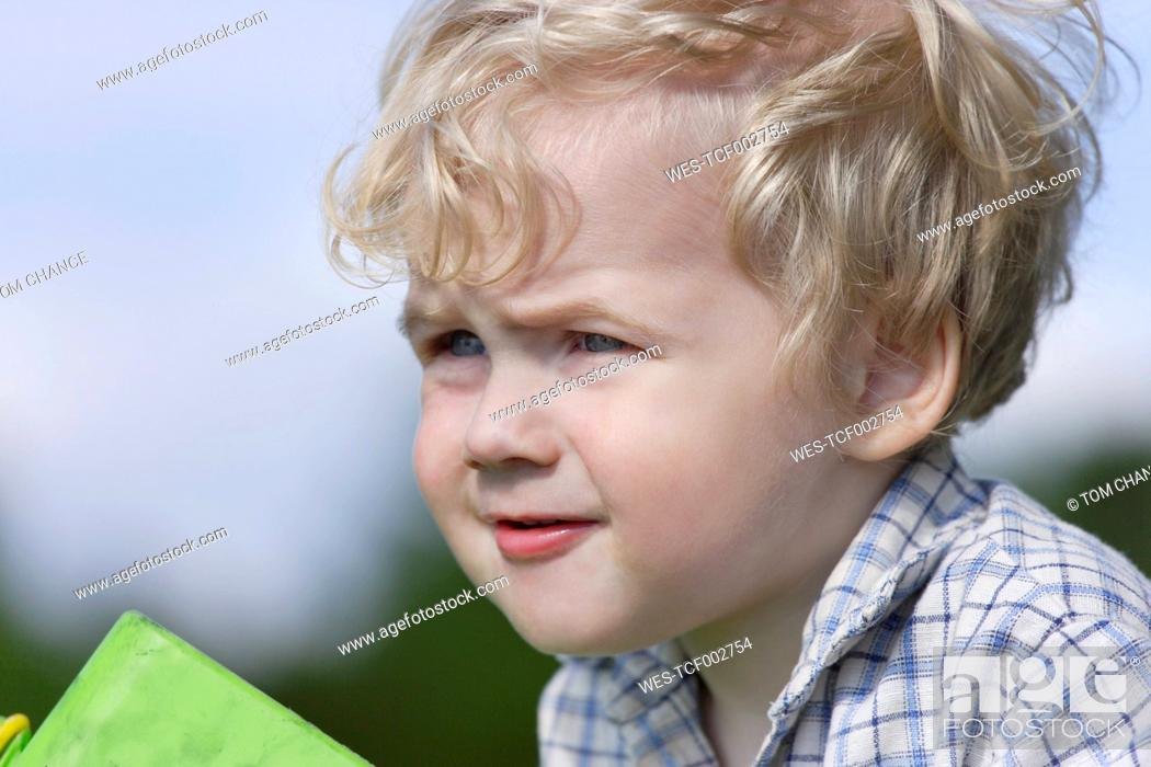 Stock Photo: Germany, Bavaria, Boy looking away, close up.