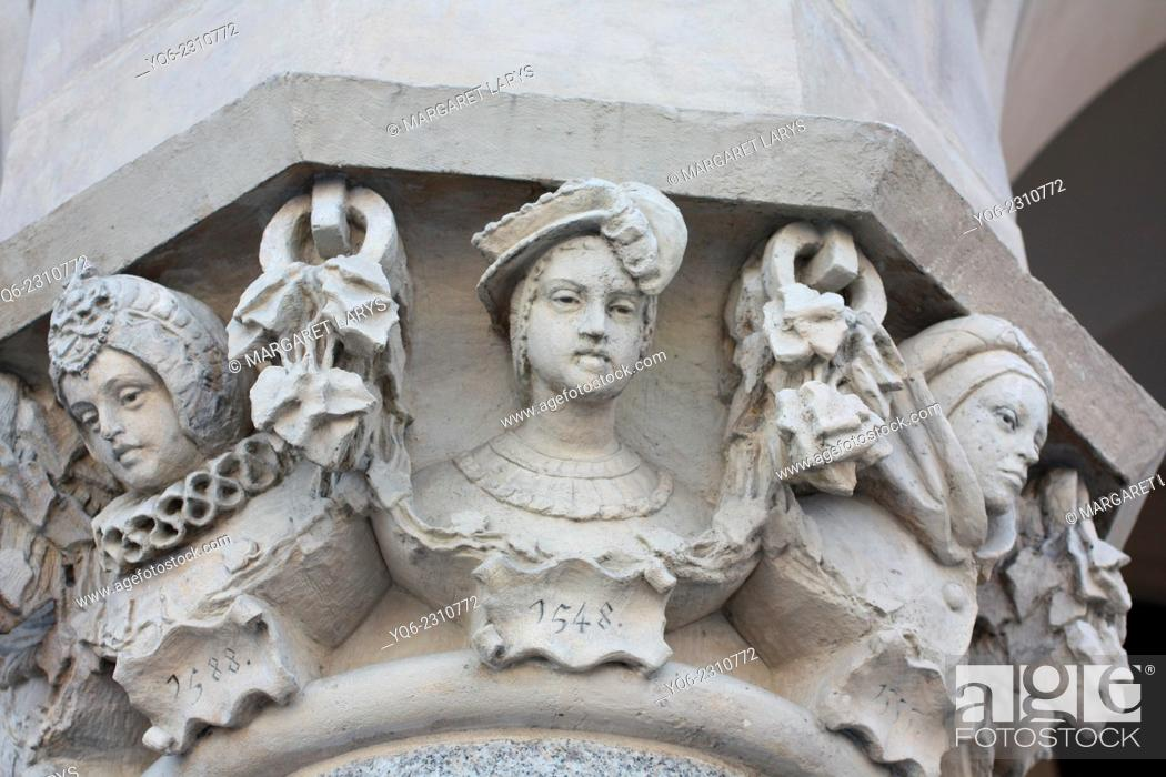 Stock Photo: Details of curved heads designed by Jan Matejko (1876-1879) a famous Polish artist, on the columns of the Cloth Hall (Polish: Sukiennice) in Kraków.