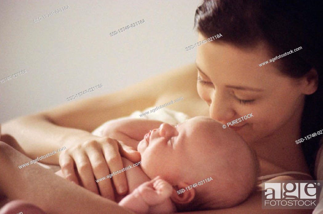 Stock Photo: Close-up of a mother lying down with her baby boy.