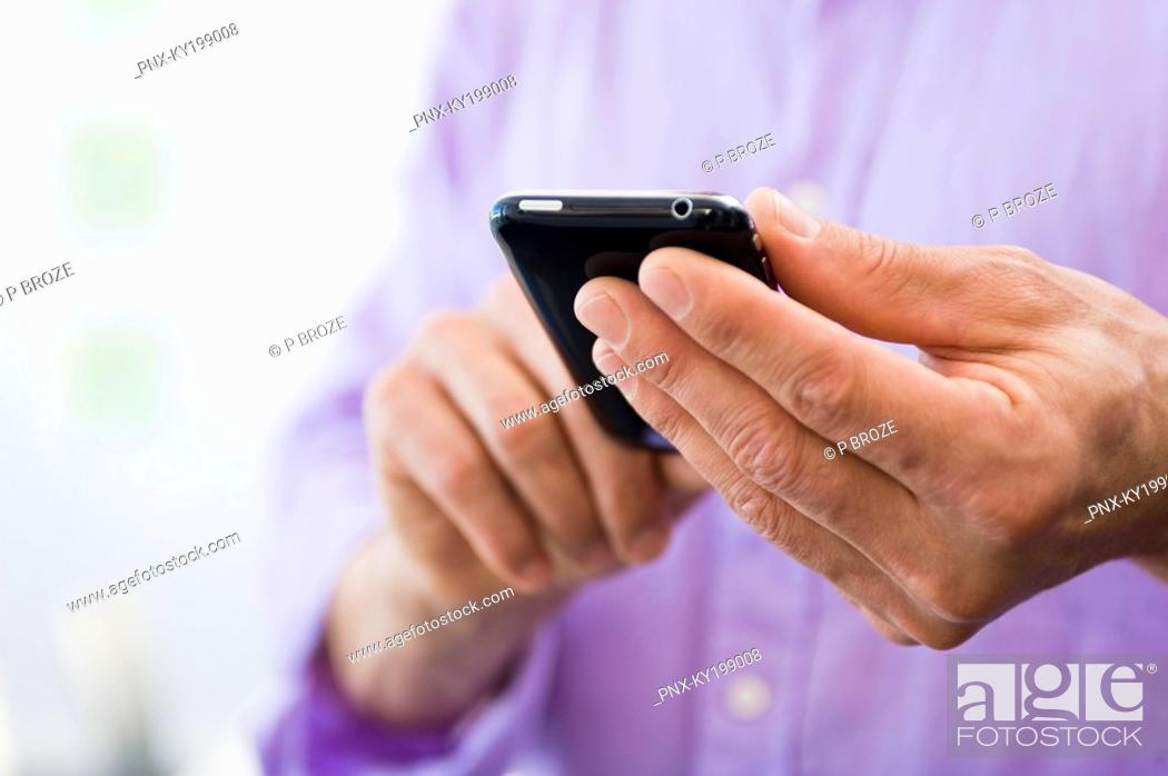 Stock Photo: Man text messaging.