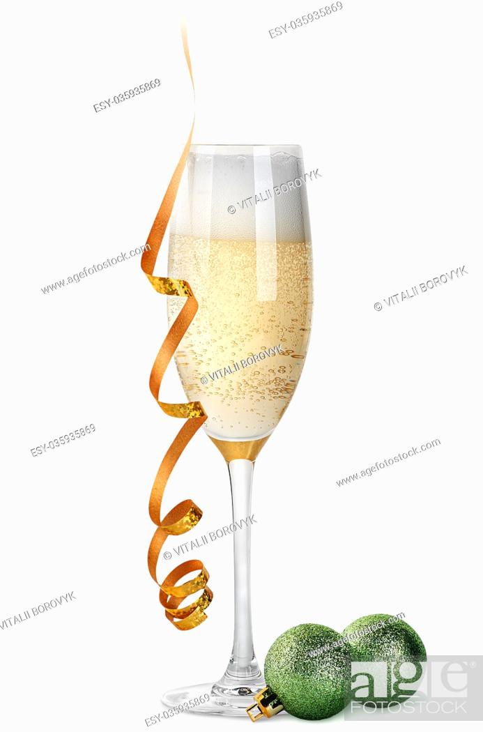 Stock Photo: Glass of champagne and Christmas balls isolated on white background.