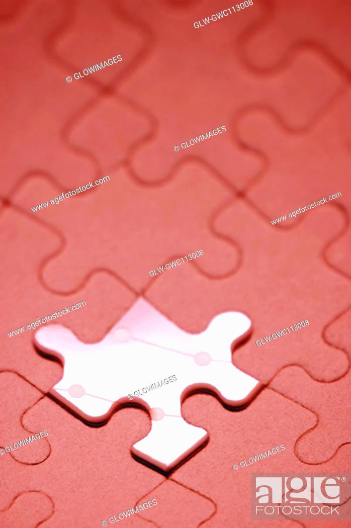 Stock Photo: Close-up of an odd piece in a jigsaw puzzle.