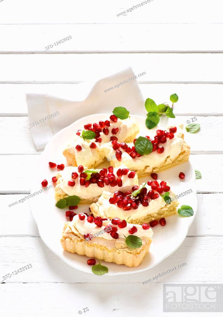 Stock Photo: Macaroon slices with pomegranate seeds.