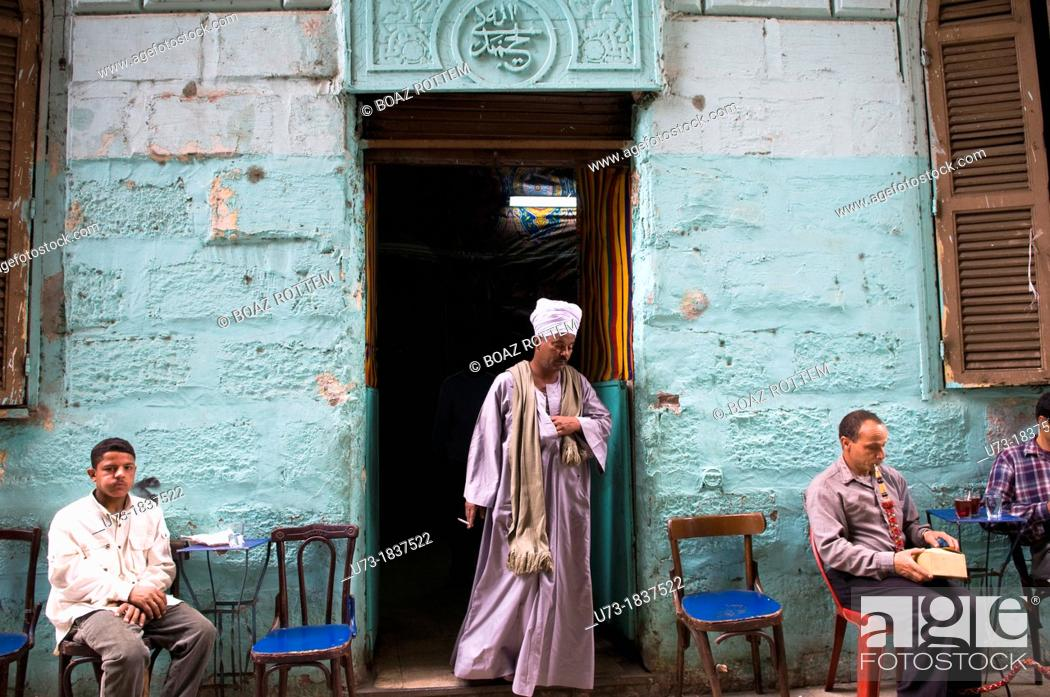 Stock Photo: A visit to a local tea house in the narrow streets of Central Cairo.